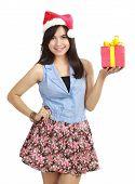 Teen Girl In Santa Hat Presenting Gift