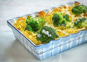 Tagliatelle pasta, broccoli and cheese sauce, and oven baked, a healthy, hearty vegetarian meal.