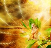 stock photo of pixie  - Beautiful sexy woman pixie sitting on a grean leaves in fantasy magic world - JPG