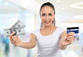 Woman With Money And Credit Card