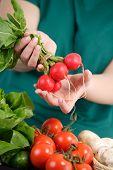 Woman Holding Fresh Vegetables