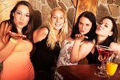 Four young girls having fun
