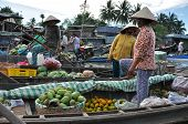 Fruit sellers in the Cai Rang floating market, Mekong delta, Vietnam