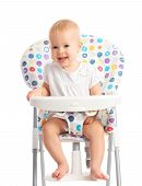 Baby Sitting In A High Chair Isolated