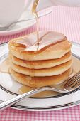 foto of buttermilk  - Pouring maple syrup on to buttermilk pancakes - JPG