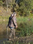 picture of duck-hunting  - A duck hunter out hunting ducks in the fall - JPG
