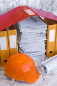 Orange helmet, project drawings and folders