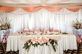 stock photo of wedding feast  - Wedding chair and table setting at restaurant - JPG