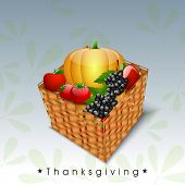 Happy Thanksgiving Day celebration concept with wooden basket full of fruits and vegetables on beautiful abstract background, can be use as flyer, banner or poster.
