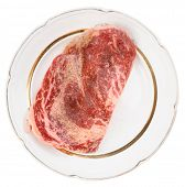 Premium quality ribeye steak oiled and peppered for frying