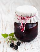 stock photo of blackberries  - Jar of Homemade blackberry jam on a wooden background - JPG