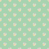 Seamless vector pattern with little green and violet hipster cupcakes on mint green background
