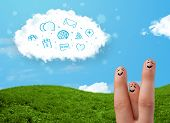 Happy cheerful smiley fingers looking at cloud with blue social icons and smybols