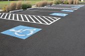 stock photo of handicapped  - Handicapped Parking Space at Business Location Parking Lot - JPG
