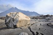 Large Boulder and Active Volcano Background