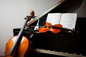 Classical music concept: cello, violin, piano and a score