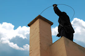 pic of sweeper  - Chimney sweeper on the roof of a house - JPG