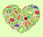 Heart from vegetables on green