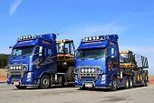 Two Volvo FH13 Trucks Hauling Ponsse Forestry Machinery