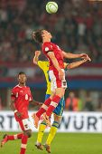 VIENNA,  AUSTRIA - JUNE  7 Alexander Kacaniklic (#19 Sweden) and Julian Baumgartlinger (#14 Austria) fight for the ball during the world cup qualifier game on June 7, 2013 in Vienna, Austria.