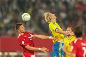 VIENNA,  AUSTRIA - JUNE  7 Ola Toivonen (#20 Sweden) and Sebastian Proedl (#15 Austria) fight for th