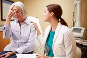 Doctor In Consultation With Senior Concerned Female Patient