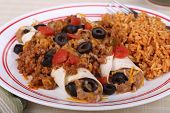 stock photo of enchiladas  - Beef and been enchiladas with black olives and rice - JPG