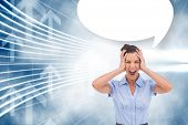 Stressed businessswoman with hand on her head and speech bubble against arrow graphics in blue and white