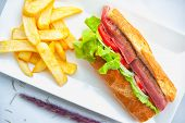 Beef Steak Sandwich And French Fries On White Dish