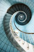 image of bannister  - A spiral staircase going up with blue tiled wall  - JPG