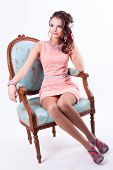 Beautiful Girl In The Spring Image Sits On A Chair In Baroque Style