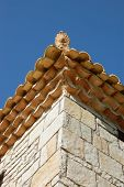 stock photo of pilaster  - Ceramic antefix decorative pottery ornament on the roof of a house in Greece - JPG