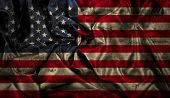 American flag background with folds and creases and a grunge effect