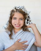 Funny kid girl smiling with his dye hair with foil blue eyes