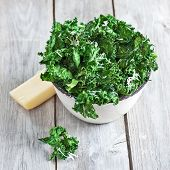 picture of kale  - Kale chips with parmigano cheese in ceramic bowl. Selective focus.