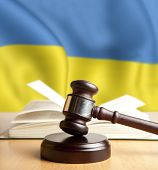 Wooden gavel and flag of Ukraine