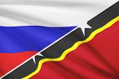 Series Of Ruffled Flags. Russia And Saint Kitts And Nevis.