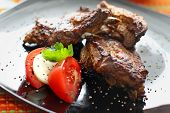 Grilled beef with tomatoes and mozzarella