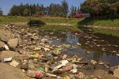 KOTA KINABALU, MALAYSIA - APRIL 26 2014: Plastic rubbish pollution in park pond. Photo showing pollu