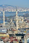 ISTANBUL, TURKEY - MARCH 23, 2014: Yeni Mosque against the Bosporus strait. Built in 1665, the mosqu