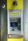 BOLOGNA, ITALY - APRIL 19, 2014: An ATM machine at a Bancoposta in Bologna, Italy, on Saturday, April 19, 2014.