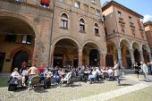 BOLOGNA, ITALY - APRIL 19, 2014: People enjoy a cafe on Piazza Santo Stefano in Bologna, Italy, on Saturday, April 19, 2014.