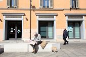 BOLOGNA, ITALY - APRIL 19, 2014: A man walks past a  Unicredit Banca di Roma S.p.A bank office in Bo