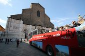 BOLOGNA, ITALY - APRIL 19, 2014: Tourists enjoy a tourthrough the city in a guided bus tour in Bolog