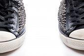 Fashion. Black gumshoes on the white background