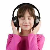 Girl Having Fun Listening To Music On Headphones