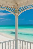 View of Varadero beach in Cuba framed by the columns of a beautiful wooden terrace