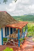 Colorful rustic wooden house with a terrace overlooking the Vinales Valley in Cuba