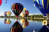 stock photo of ascension  - Hot air ballooning mass ascension reflection - JPG