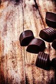 Closeup brown chocolate candy background. Chocolate truffles